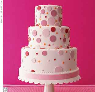 A pink polka dot wedding cake