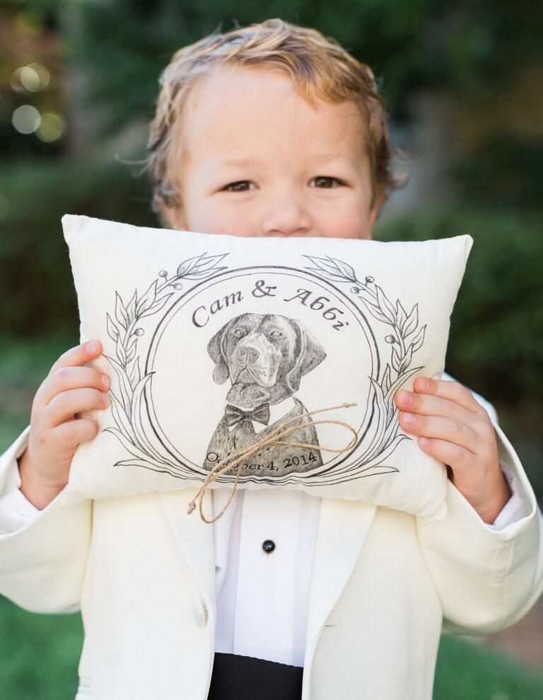 Ring bearer holding custom illustrated ring pillow