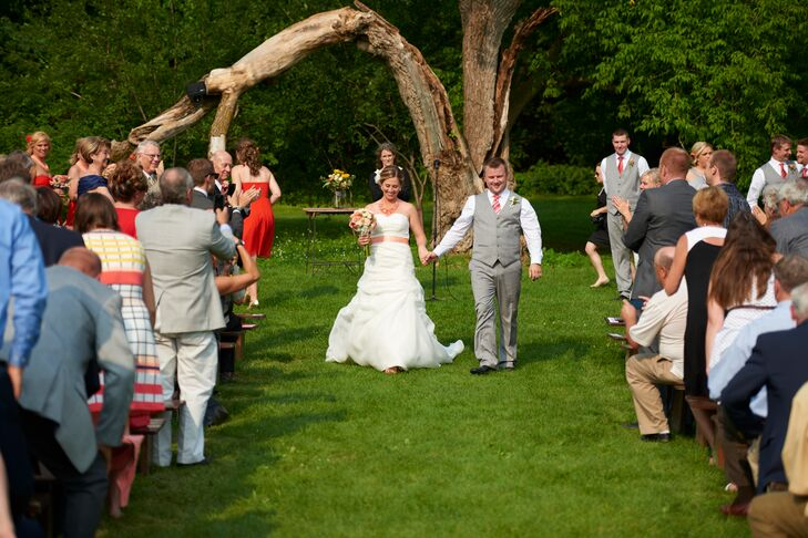 The couple exchanged vows in front of a big, old tree at Hope Glen Farm in Cottage Grove, Minnesota.