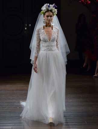 Naeem Khan Fall 2016 long sleeve wedding dress with lace appliqué bodice and pleated skirt