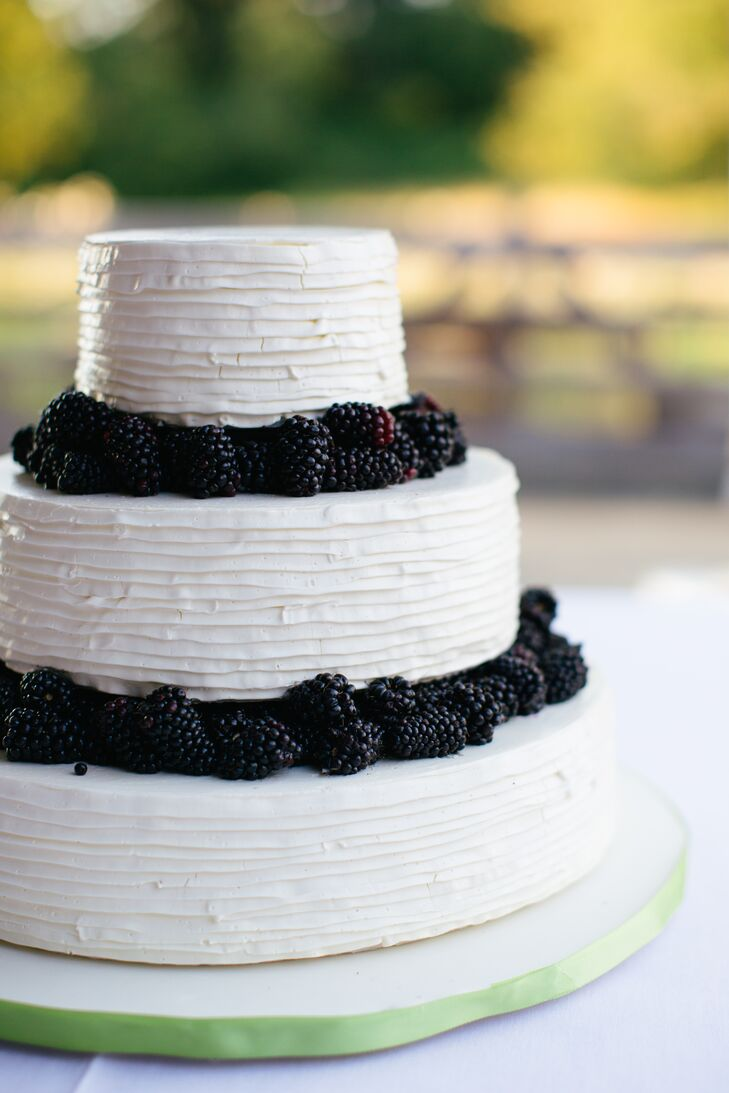The three-tiered wedding cake was a simple white cake topped with fresh blackberries.