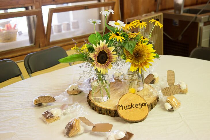 rustic centerpiece with sunflowers in mason jars