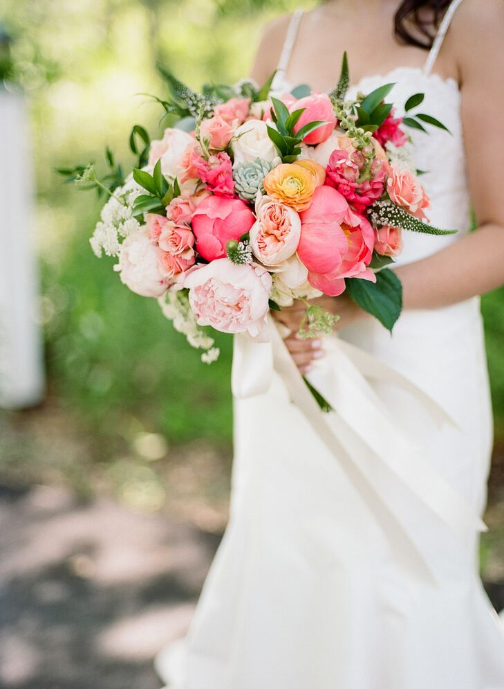 """Our flowers were pretty simple and minimal because our landscape and backdrop were so lush and beautiful on their own,"" Jamie says. ""I love peonies—they go perfectly with Kate Spade—so we absolutely had to have those, and the garden roses added a nice balance."" The bride's bouquet also incorporated wildflowers native to Maine and succulents for texture."