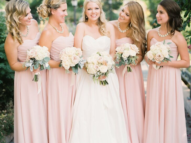 """I fell in love with the heart-shaped neck and ball gown skirt because it made me feel like a bride,"" Andrea says of her classic ball gown. Andrea's bridesmaids wore flowing blush gowns with sweetheart necklines."