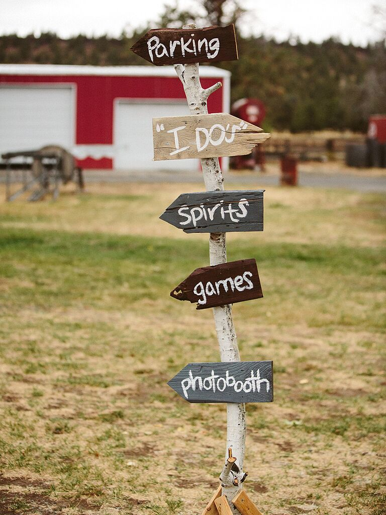 Rustic wedding sign with parking, spirits, games and the photobooth