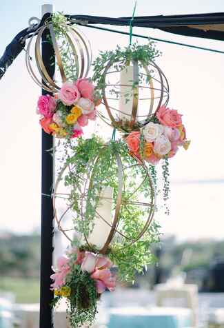 Gold hanging decorations with greens and flowers