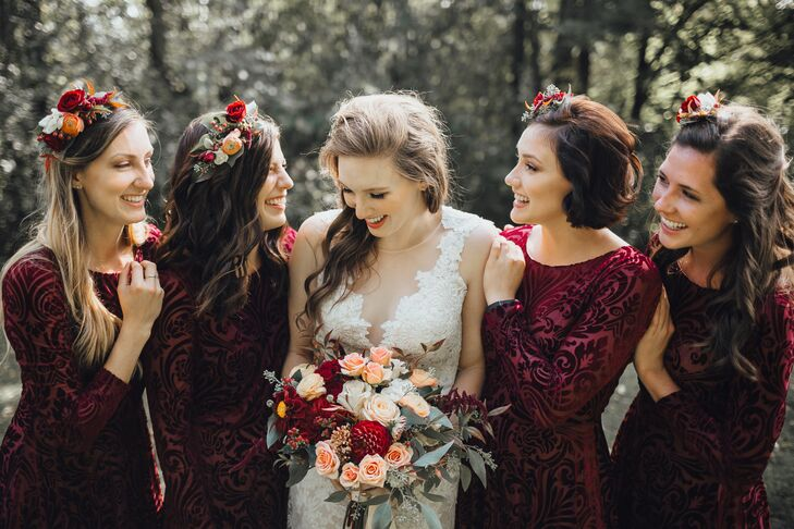 Bridesmaids in Burgundy Velvet Gowns and Flower Crowns