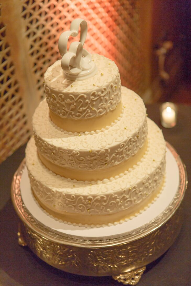 Elegant, Three-Tier Wedding Cake with Gold Accents