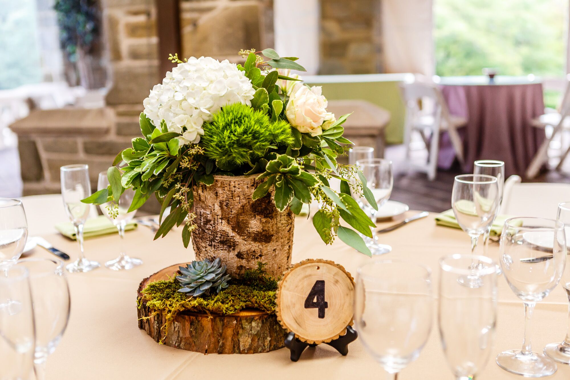 Birch wood centerpieces with hydrangeas and greenery