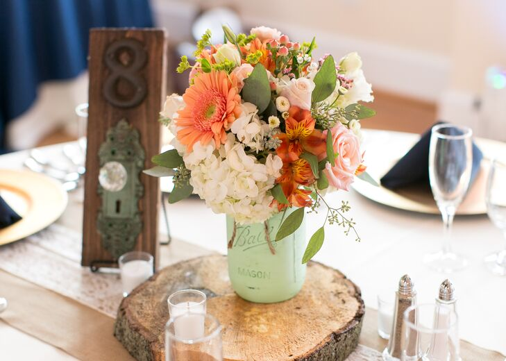 Wood slab centerpieces with mint mason jars and doorknob