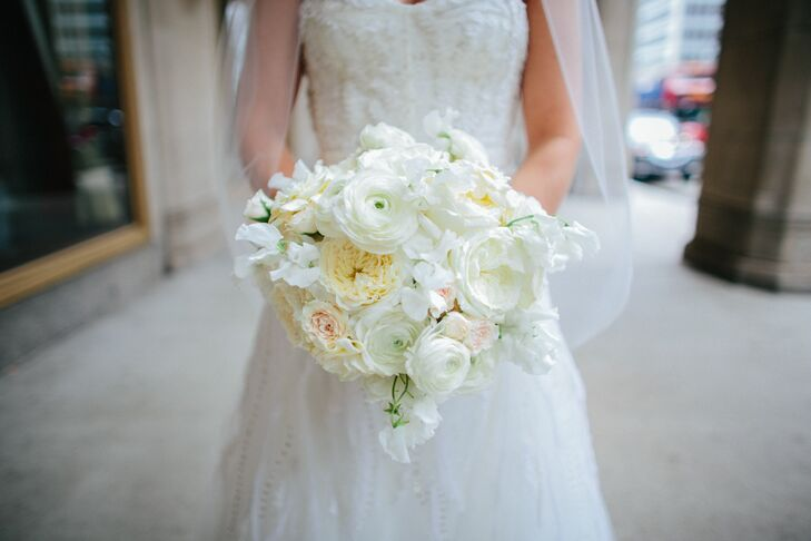 Liz carried a classic, lush bouquet filled with ivory ranunculus, white garden roses, dusty miller and hydrangeas.