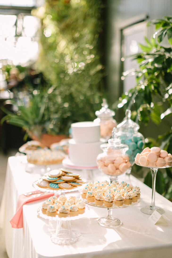 A dessert table was laden with macarons, cupcakes, cookies and a small almond apricot wedding cake.