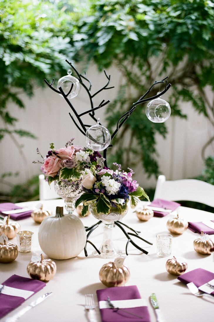 While crystal chalices overflowing with cheerful garden florals brought a pop of bright color and an air of femininity to the centerpieces, branch-like structures decked out with votive candles in floating glass orbs introduced an element of playfulness to the tabletops.