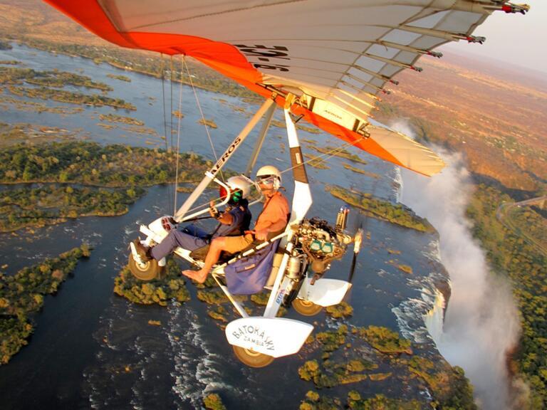 a couple on a microflight plane