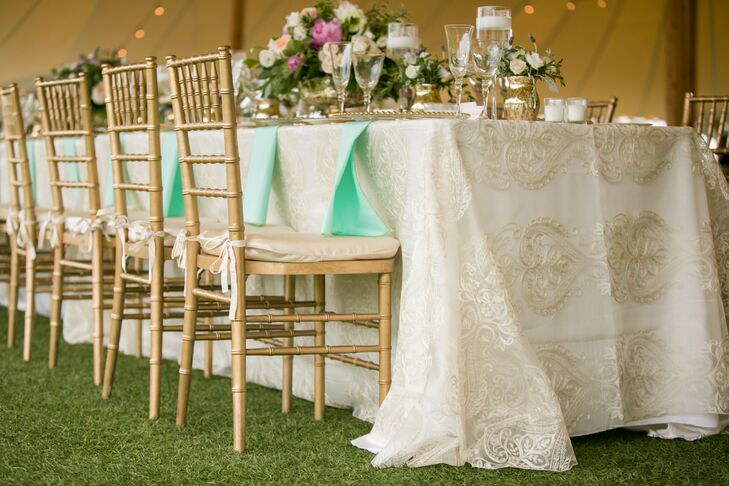 Each table had gold mercury glass arrangements of ivory, peach and blush. Table linens consisted of blush and ivory satin underneath a gold lace overlay. Each place setting had a gold chiavari chair, a gold beaded charger, gold flatware and glassware with a thin gold rim.