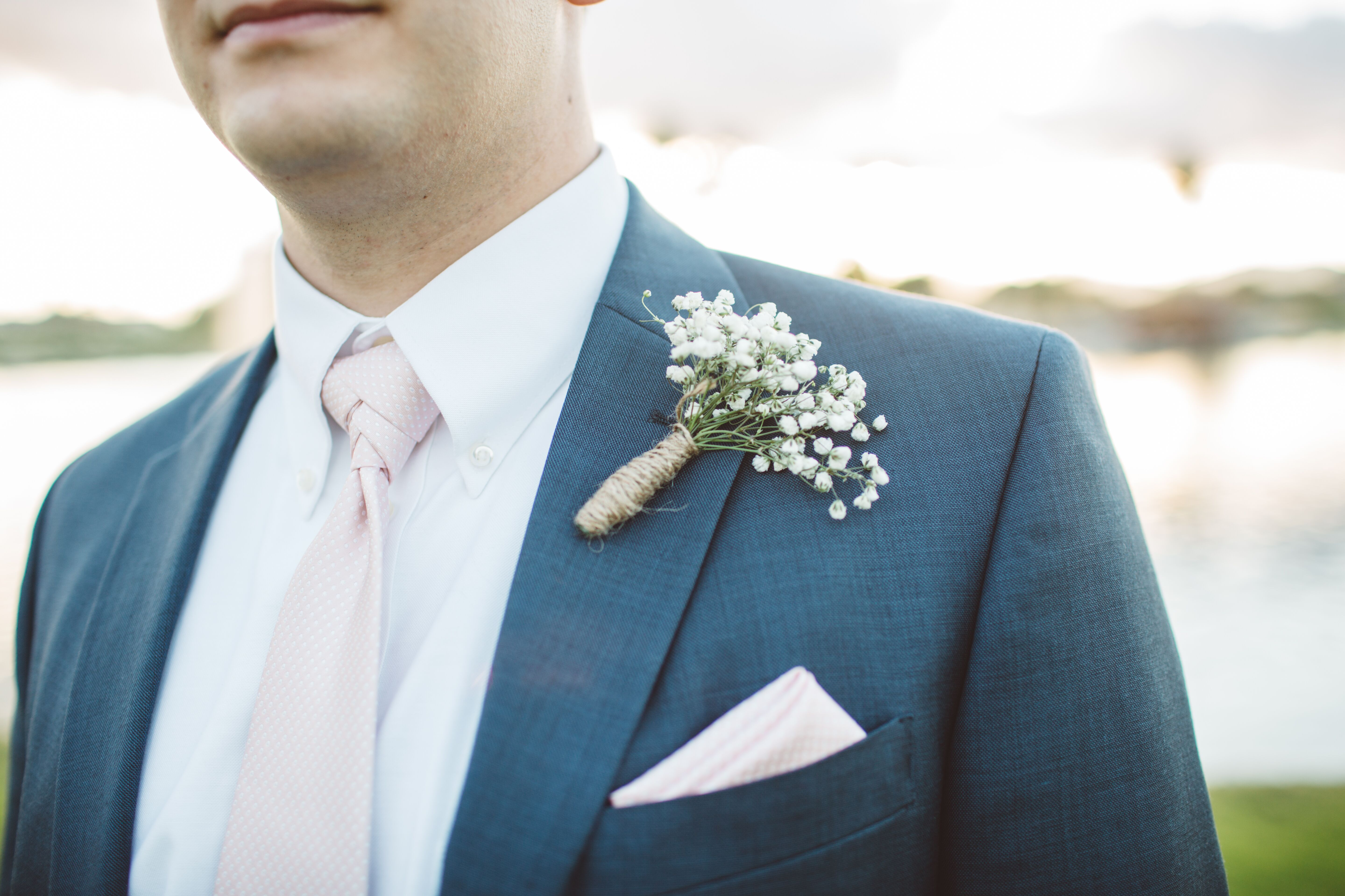 Baby\'s Breath Boutonniere and Blush Tie with Navy Suit