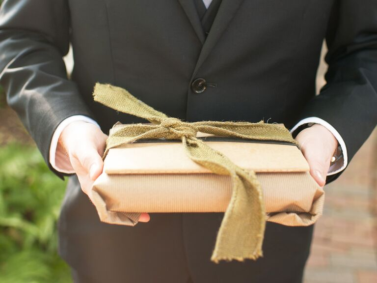 Wedding guest with gift for couple