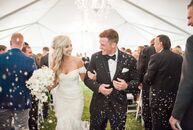 Orchids, candlelight and a soft palette of blush and champagne gave a romantic vibe to Erin Sickels (23 and a business owner) and Ben Dittmer's (27 an