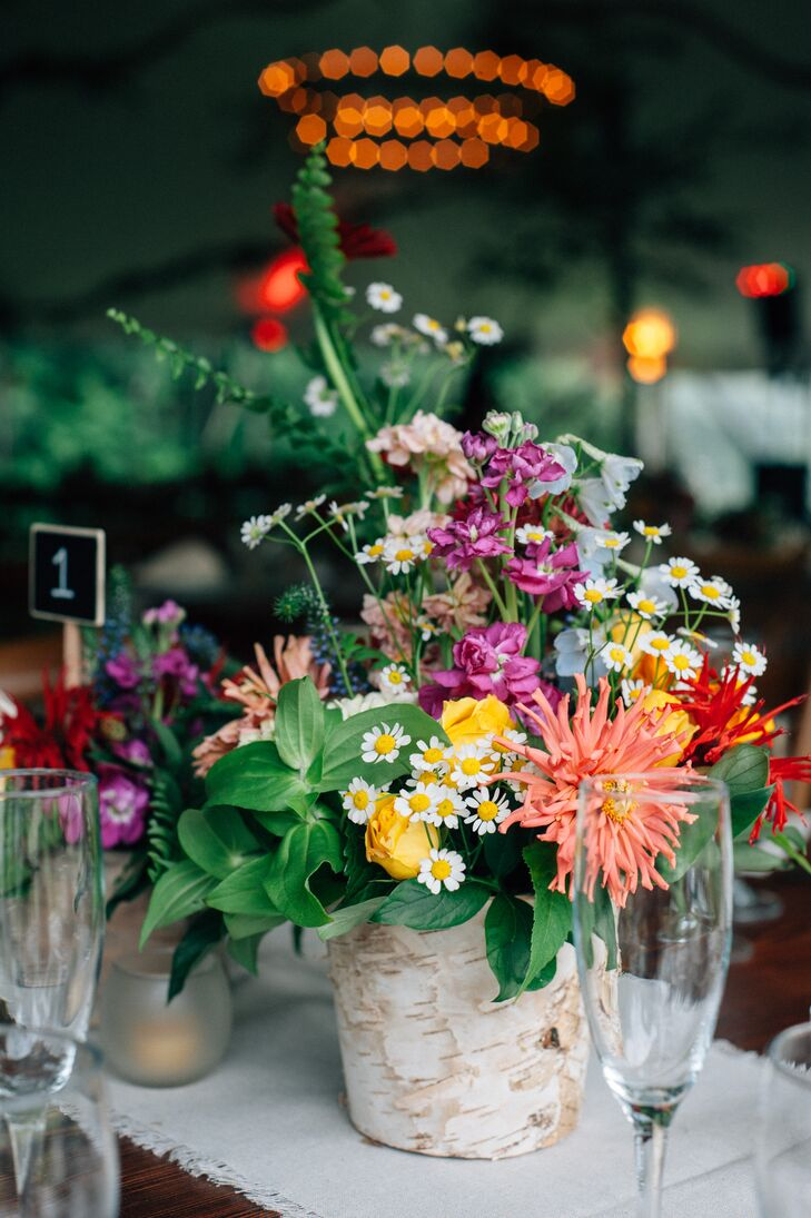 Vermont's natural beauty served as an endless source of inspiration for the decor. Birch vases spoke to the lush woodland setting, while fresh, colorful florals made for centerpieces with a just-picked feel.