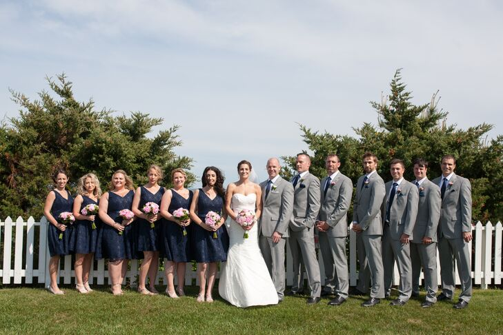 Bridesmaid navy dresses and gray suits photos