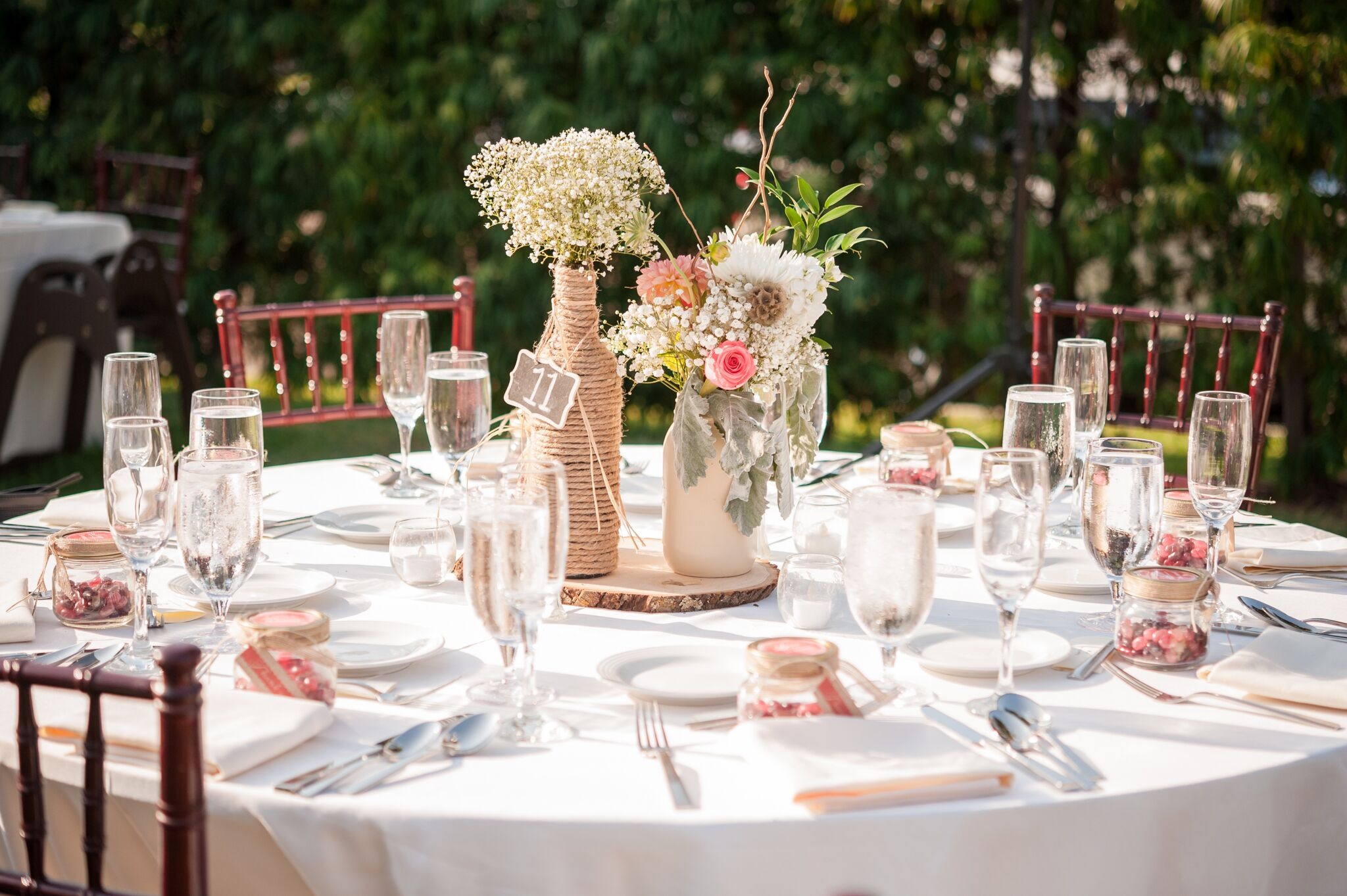 Ivory Dining Table with Rustic Centerpieces