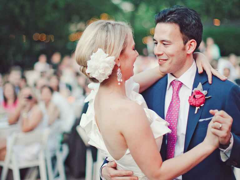 Bride and groom first dance at outdoor wedding reception