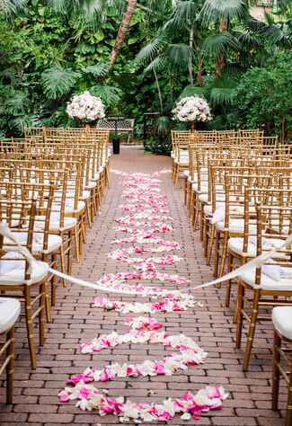 Wedding ceremony aisle lined with flower petals