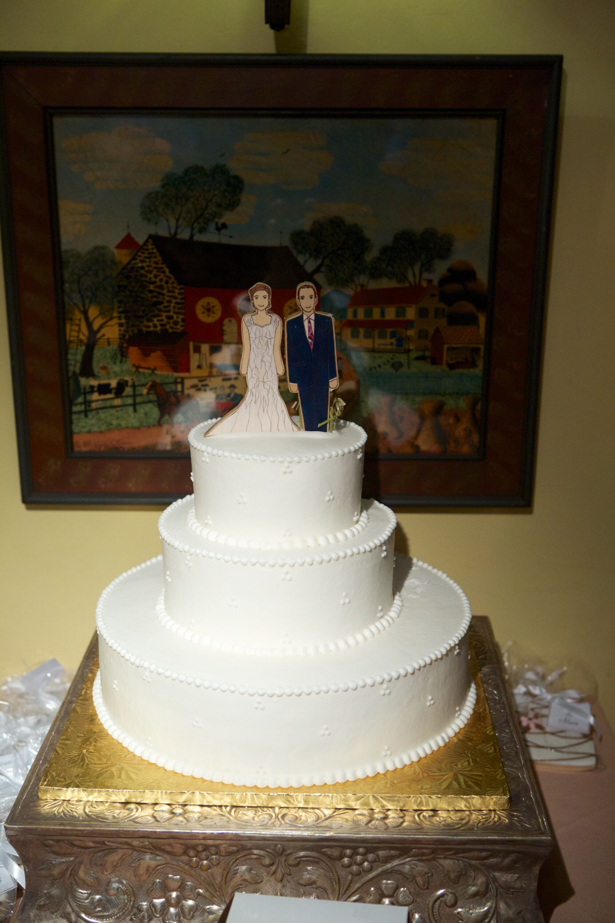 Three Tier White Wedding Cake with Bride and Groom Topper