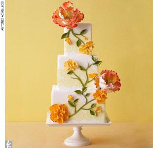 Floral wedding cake with yellow lace trim
