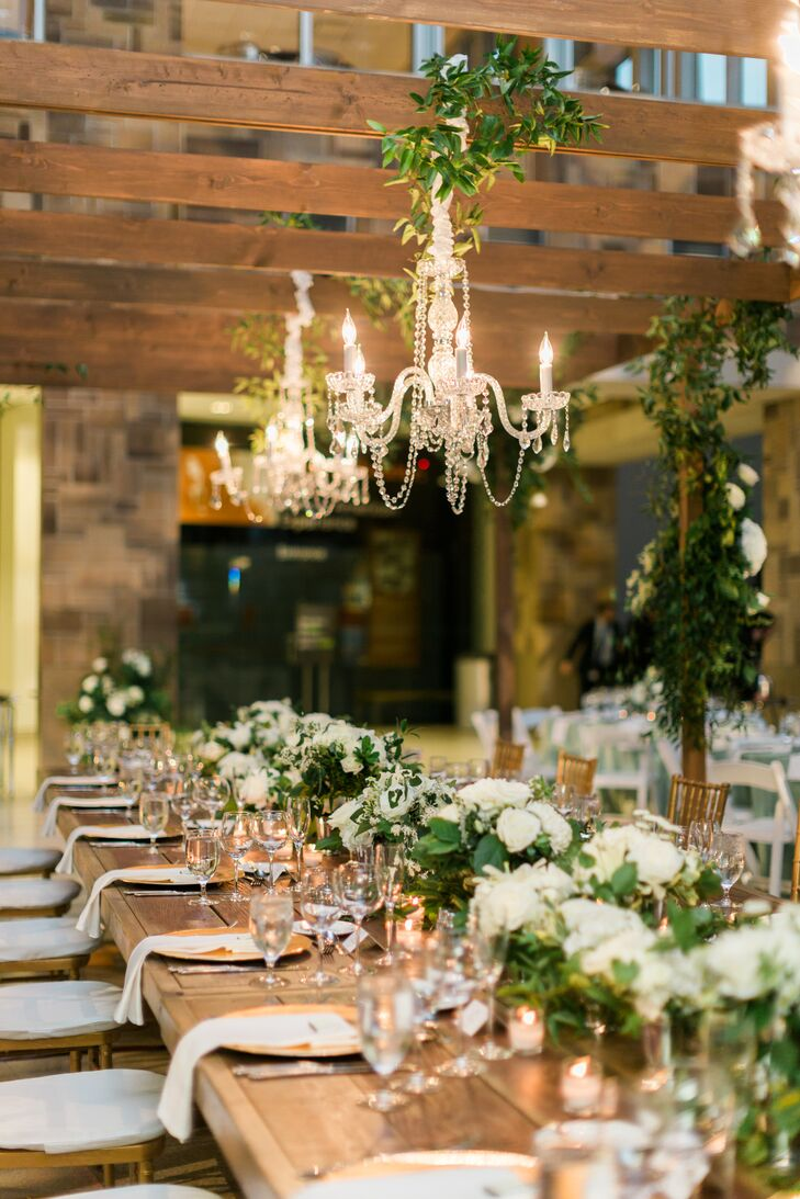 "Local florist David Stroymeyer described their wedding as ""A Midsummer Night's Dream in Napa."" Says Margaret, ""We wanted the venue to feel lush and romantic. Lots of greenery.""  Chandeliers added a touch of glam."