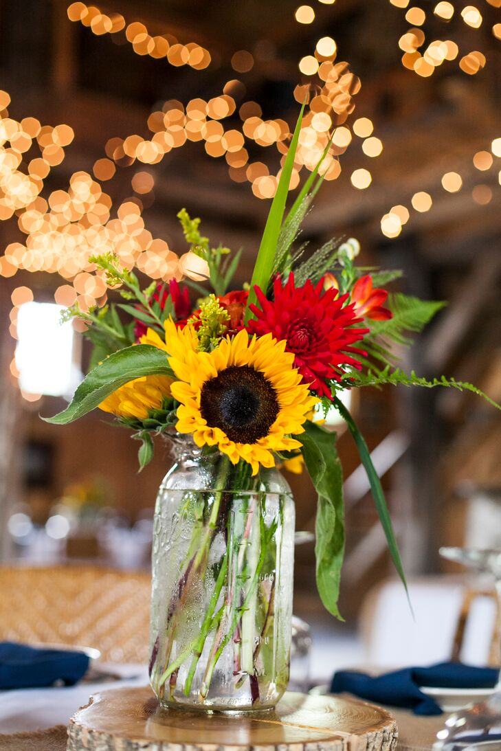 Vibrant gerbera daisy and sunflower centerpieces