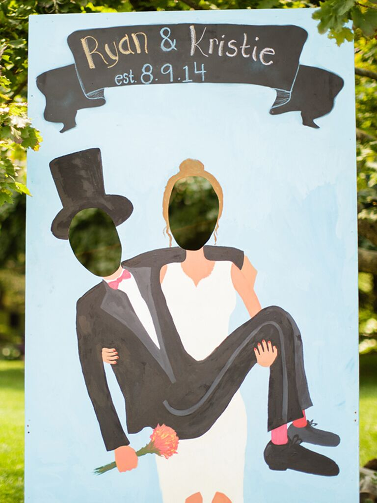 Cute Wedding Photo Booth Idea With A Stand Up Newlywed Cutout