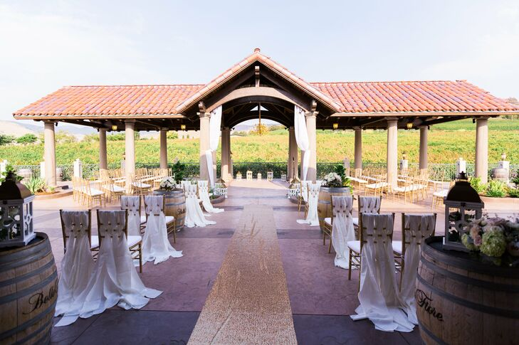 """Jay and I love wine. We knew we wanted a venue that was outdoors yet elegant,"" Andrea says of Belle Fiore Estate & Winery in Ashland, Oregon. The couple said ""I do"" under a pavilion overlooking the vineyard and mountains."