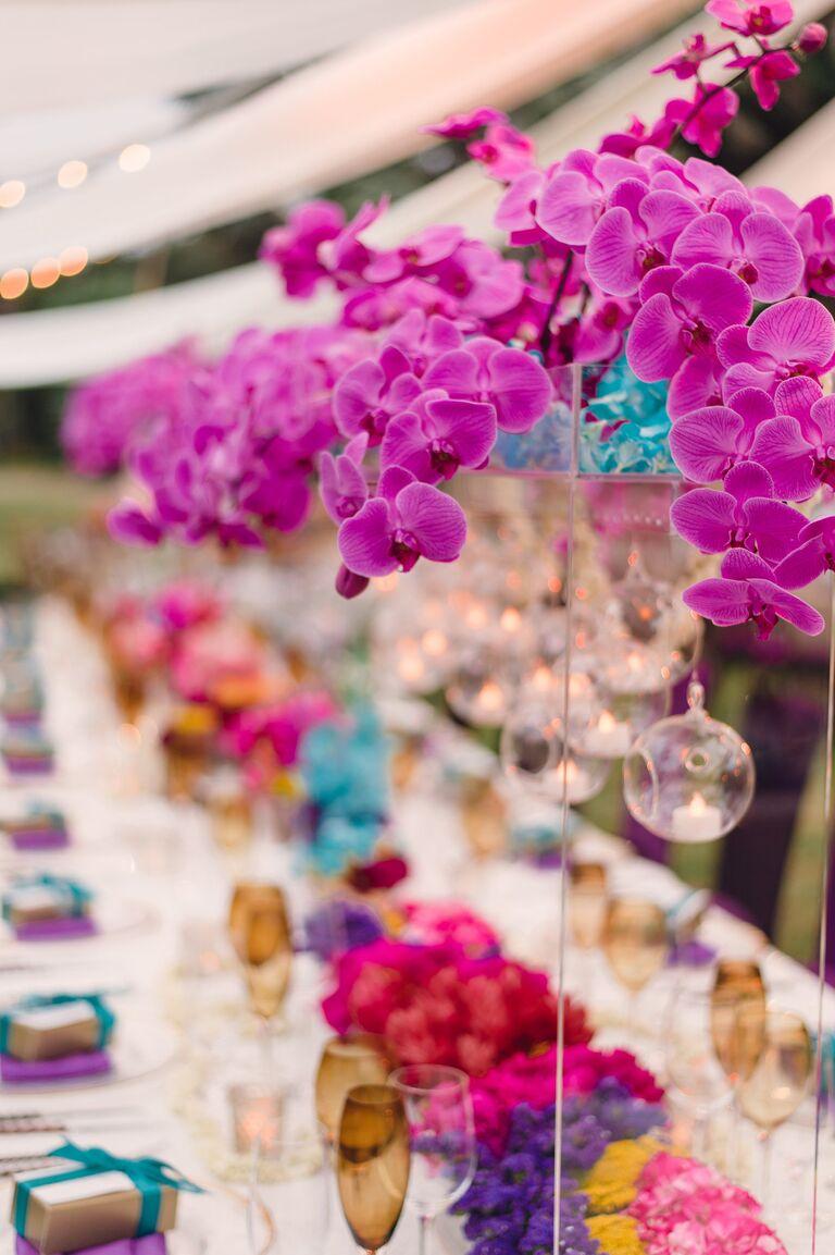 Wedding flowers symbolic meanings tall purple orchid reception centerpiece biocorpaavc