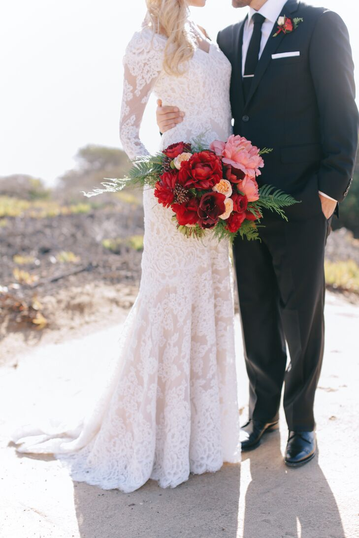 Carlie's sleeved wedding gown and bouquet of deep oxblood blooms created a dramatic, slightly vintage bridal look.