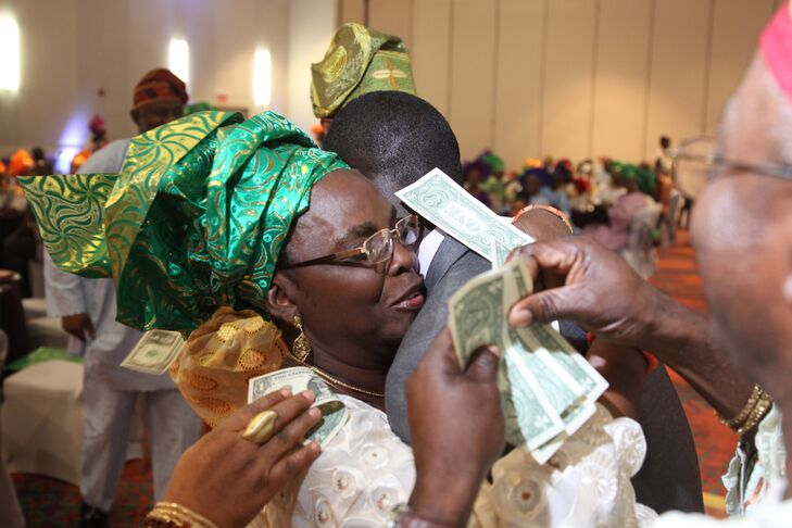 At the reception, Omotayo and Mayowa celebrated with a traditional Nigerian money dance where guests could spray small bills on the happy couple to symbolize their hopes for good fortune. The bride and groom also had a couple dance competition to keep guests on their feet and thoroughly entertained.