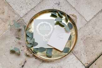 Vows and program on a gold tray