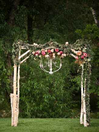 Romantic birchwood and leaf garland arch with a chandelier