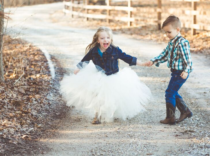 Amanda's son was the ring bearer and wore a brown, teal and ivory plaid button-up with brown cowboy boots and leather suspenders. The flower girl (her son's best friend) wore a jean jacket with a huge ivory tutu made by Amanda for the occasion.