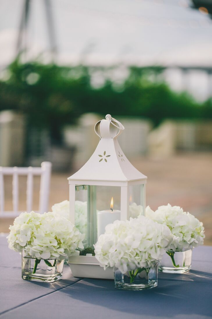 White lanterns candles hydrangea centerpieces