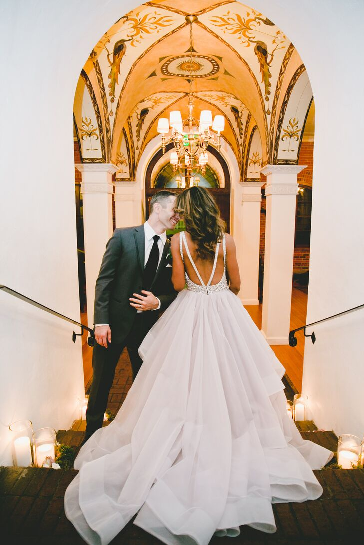 """My favorite part of the dress was the back,"" says Esme, who was attracted to the ""cake-topper"" style Hayley Paige dress for its luscious full skirt and incredible detailing. ""It's difficult to make a cake topper look sexy, but the back on my dress blended sweet, sophistication and sexy."""