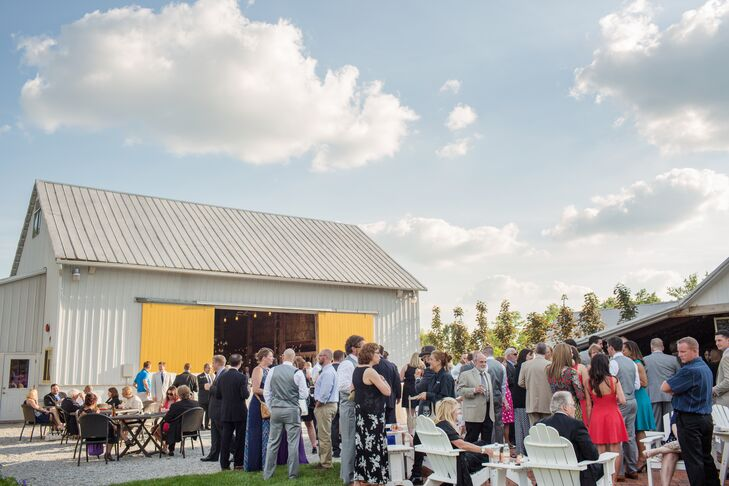 The reception took place inside and outside the rustic onsite barn at Jorgensen Farms, where guests mingled and socialized with one another.