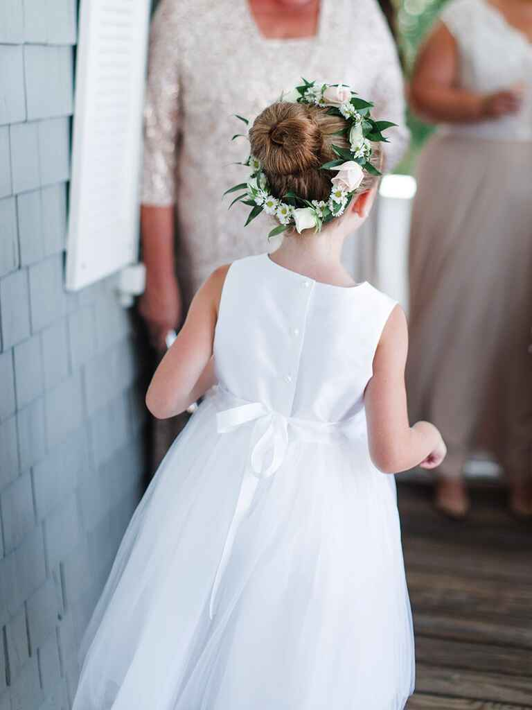 Simple bun hairstyle with wreath for flower girls