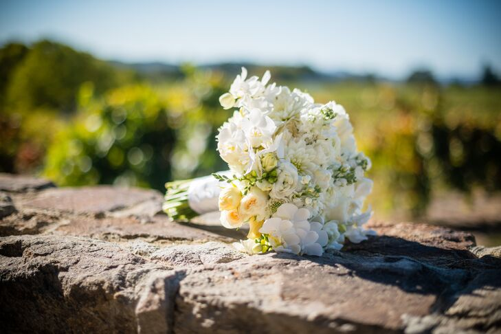 Tia held a bouquet filled with a mix of ivory flowers, which included hydrangeas, roses, scabiosa and dahlias. The flower bouquet was arranged by Barbara Vakassian Florals, and similar assortments of flowers were found in the aisle decorations and the dining table centerpieces.