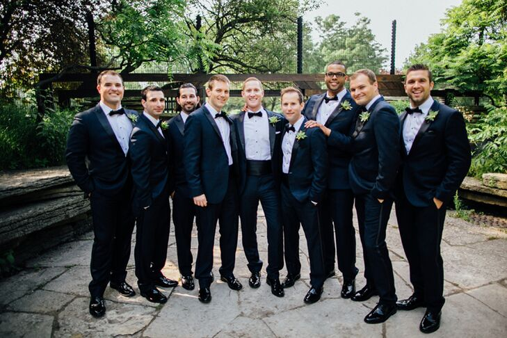 Kent wanted to rent a navy suit but had a hard time finding that at a big-box tux shop. He came across a midnight blue tuxedo online through TheBlackTux.com that fit like a glove. The online service came in handy since three of the eight groomsmen were from out of state.