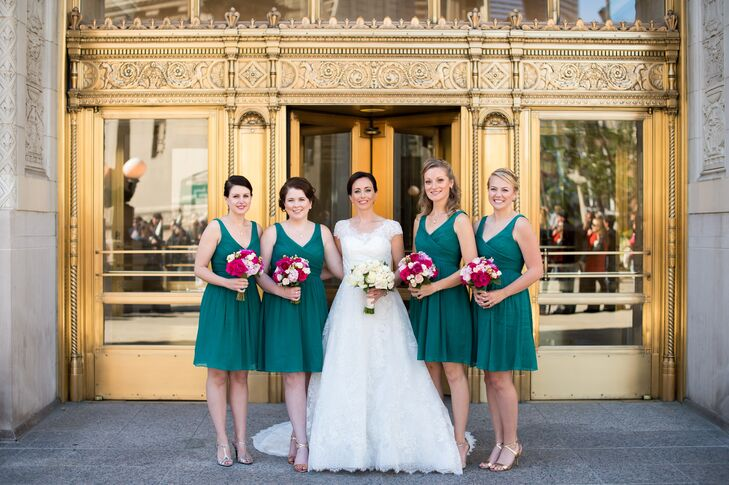 Katherine's bridesmaids wore fun yet elegant matching mini dresses in a deep peacock green shade.