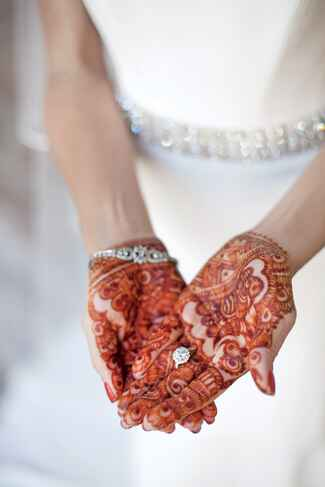 Traditional wedding dress with cultural Henna painted hands