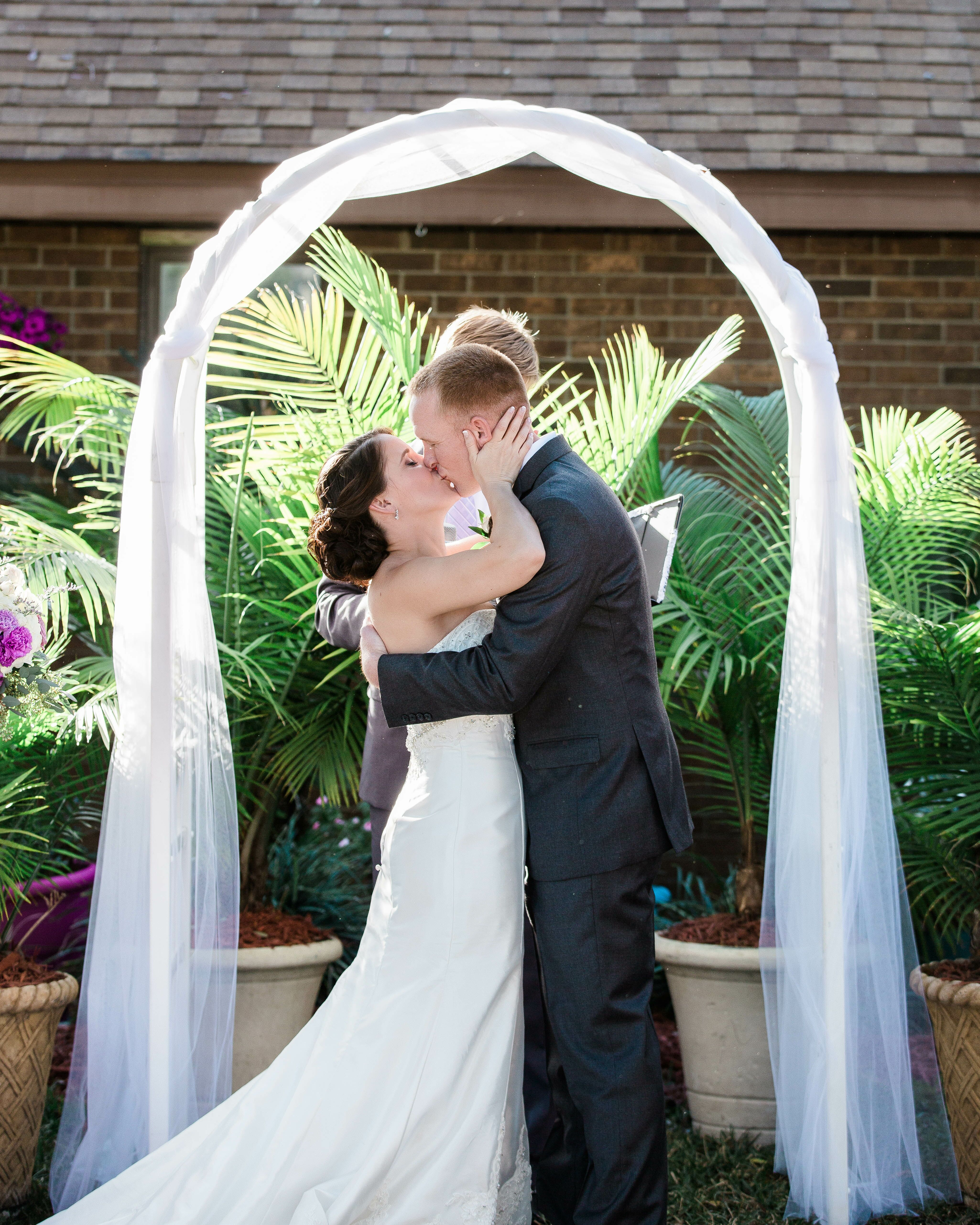 Tulle Arch Decorations Wedding Ideas: Simple White Tulle-Draped Wedding Arch In Lakeland, Florida