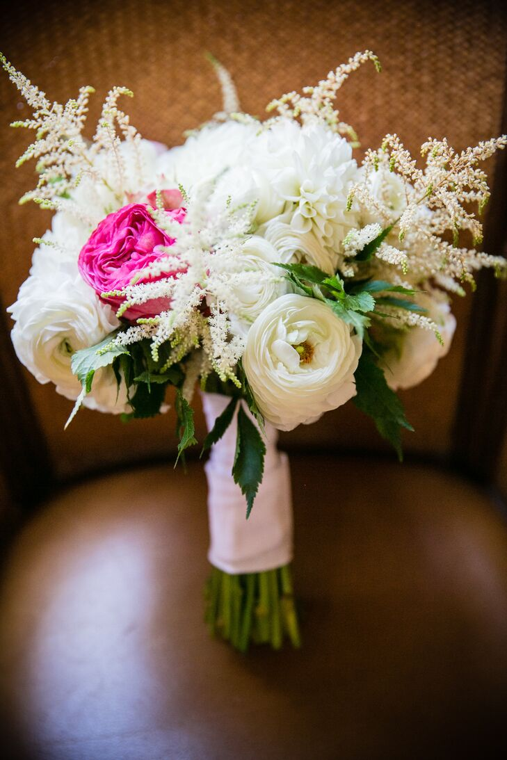 Caitlin's bouquet was smaller in size, but packed a punch with vibrant pops of fuchsia and textured, white astilbe flowers.