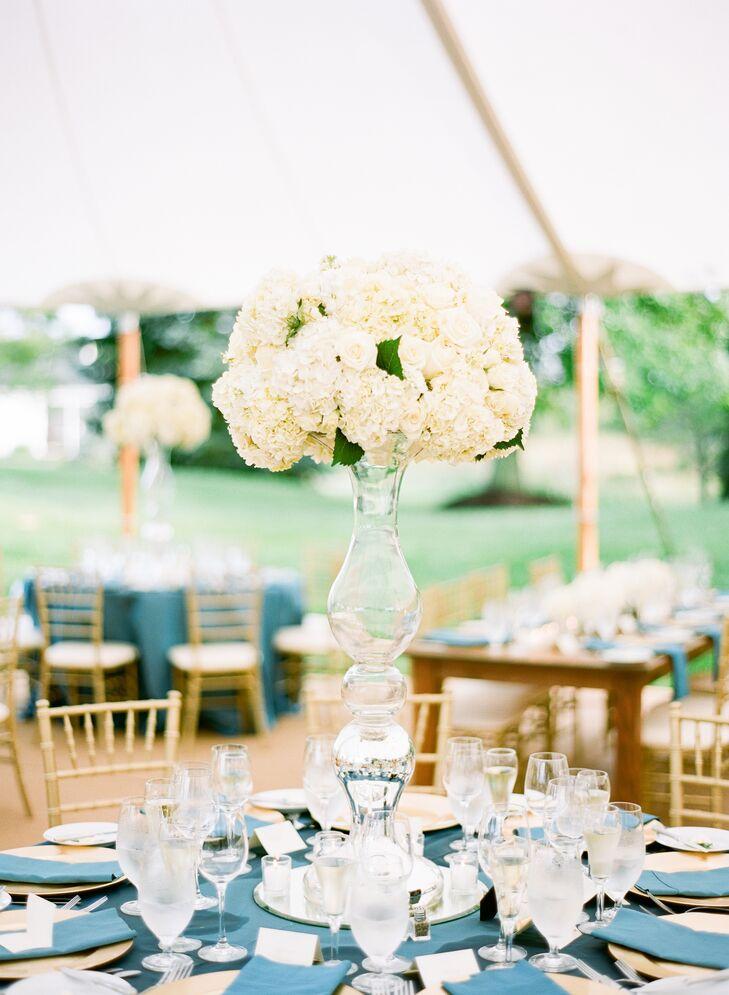 White Flower Centerpiece In Tall Vase